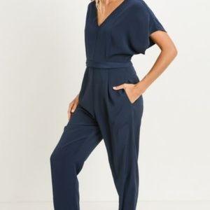 Pants - Jumpsuit featuring a v-neckline